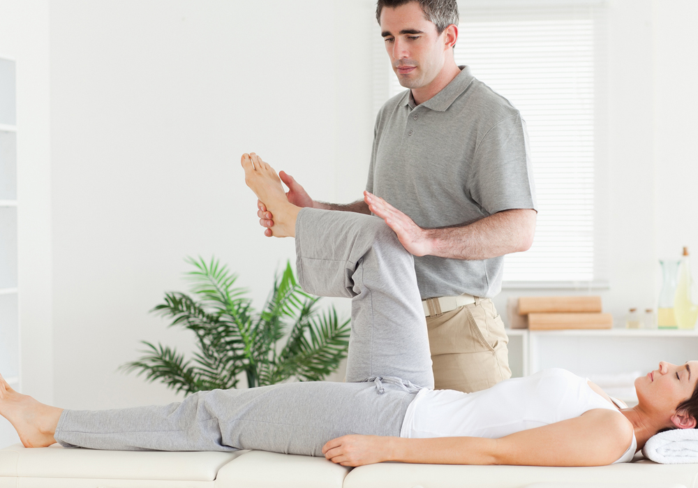 chiropractor helping a patient stretch
